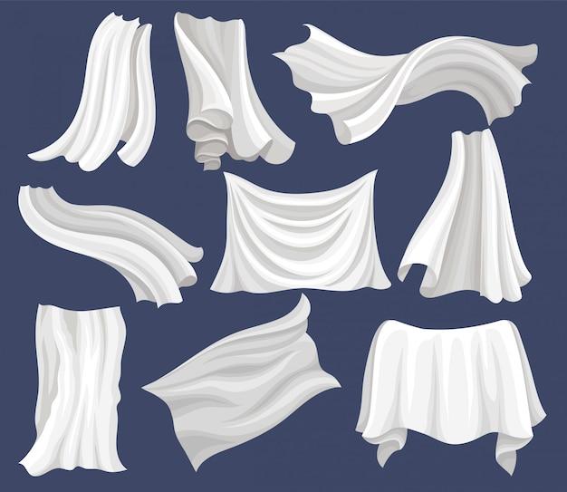 흰 천으로 설정합니다. 실크 침대 시트. 바람에 날리는 커튼. 섬유 상점의 포스터 또는 배너 요소