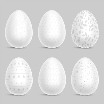 Набор белых украшенных пасхальных яиц