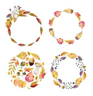 水彩の秋の木の葉と森の果実の手描きイラストの花輪のセット