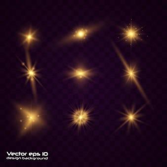 Набор из желтого золота светящийся свет взрывается на прозрачном фоне. сверкающие магические частицы пыли. яркая звезда прозрачное сияющее солнце, яркая вспышка. взрыв с пылью и блеск изоляции.