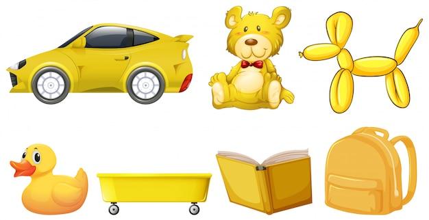 Набор желтых предметов Бесплатные векторы