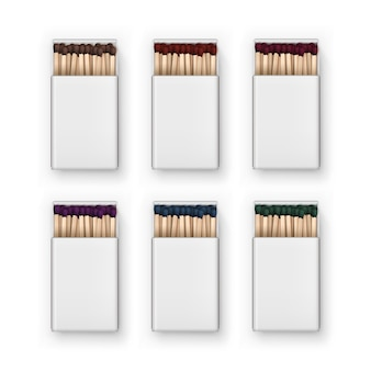 Set of opened blank boxes of colored brown red blue green purple matches top view  on white background