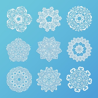 Set of ornamental snowflakes. indian mandala style. element for design. round lace.