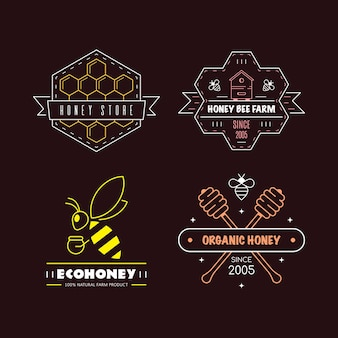Set of outline logo design templates. organic and eco honey labels isolated on black background. honey production company, honey package.