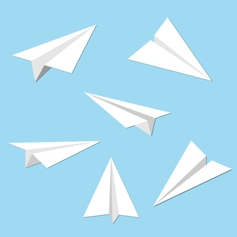 Set of paper planes on blue background