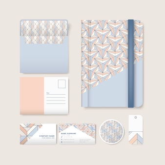 Set of pastel geometric pattern on blue surface stationery