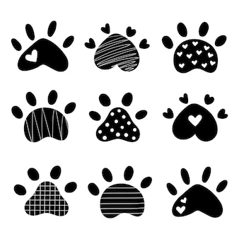 Set pet paw silhouette dog paw doodle style