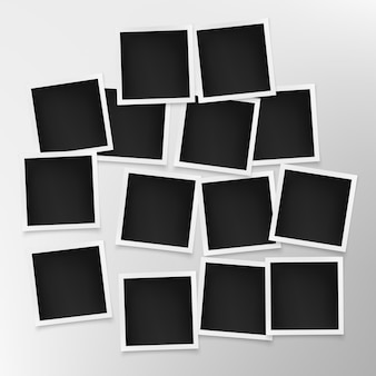 Set of photo frames on grey wall.