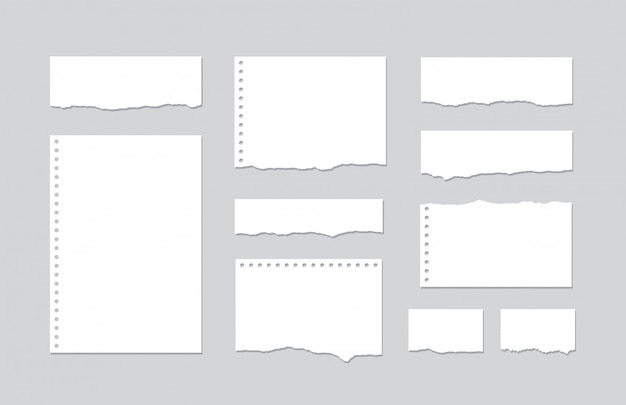 Set pieces of torn white lined notebook paper on gray