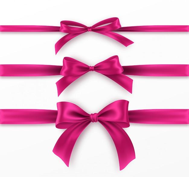 흰색 바탕에 분홍색 활과 리본을 설정합니다. 현실적인 분홍색 나비.