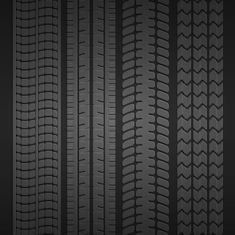 Set of prints from different types of tires on a dark gray background. vector illustration