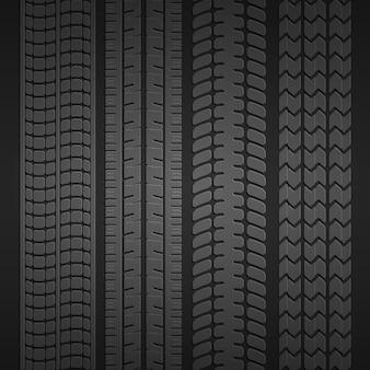 Serie di stampe di diversi tipi di pneumatici su uno sfondo grigio scuro. illustrazione vettoriale