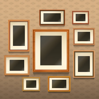 Set of realistic empty picture frames on wall
