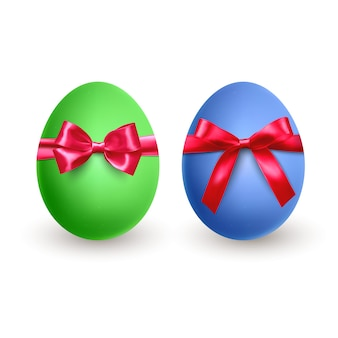 Set of realistic green and blue easter egg, with red bow