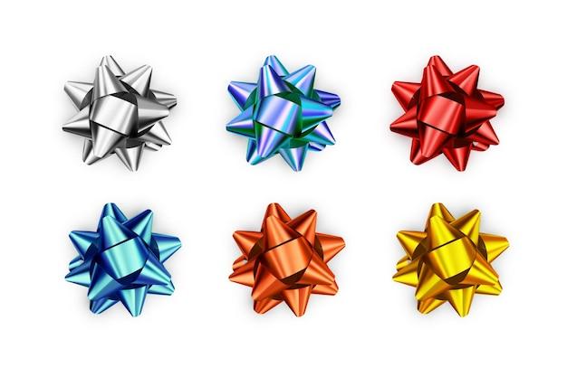 Set of realistic shiny bows isolated on white background