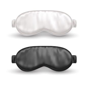 Set of realistic white and black eye mask for sleep or night blindfold.