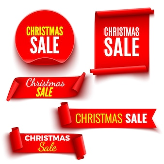 Set of red christmas sale banners. ribbons and round sticker. paper scrolls.