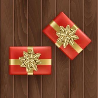 Set of red gift boxes with realistic golden ribbon top view.