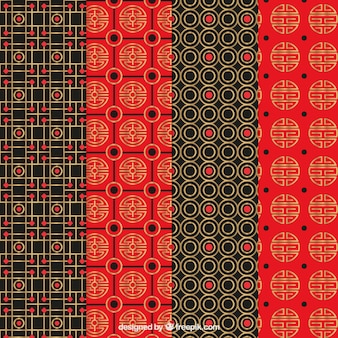 Set of red patterns with golden abstract shapes