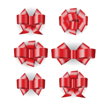 Set of  red ribbon bows isolated on white background with shadow.