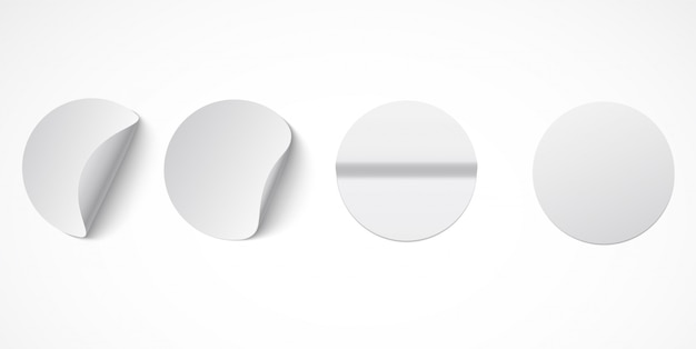 Set of round white sticky labels with bent edges.