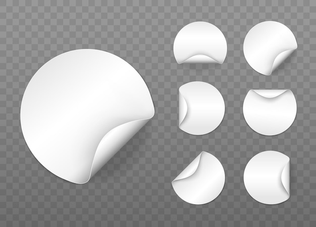 Set of round white sticky labels with bent edges