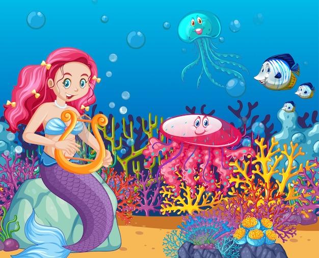 Set di animali marini e sirena in stile cartone animato sullo sfondo del mare