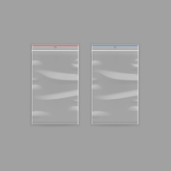 Set of sealed empty transparent plastic zipper bags close up isolated on background