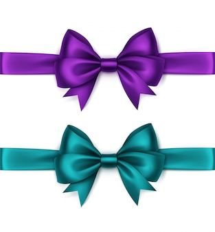 Set of shiny turquoise purple violet satin bows and ribbons top view close up isolated on white background
