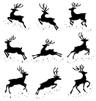 Set of silhouettes of running deer on the stars.
