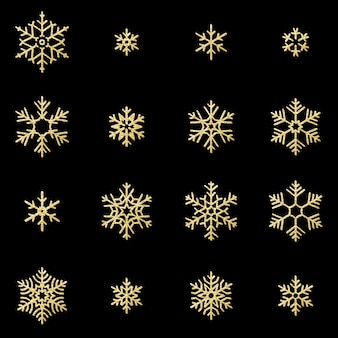 Set of sixteen shine relief golden snowflakes  on black background. new year and christmas card glittering decoration object.