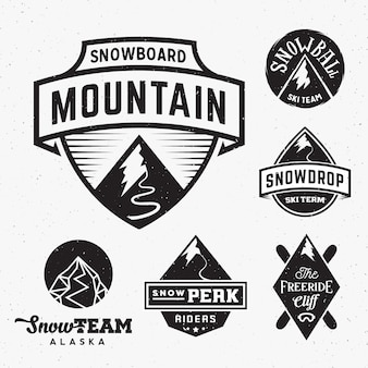 Set of snowboard sport logos, with shabby texture isolated