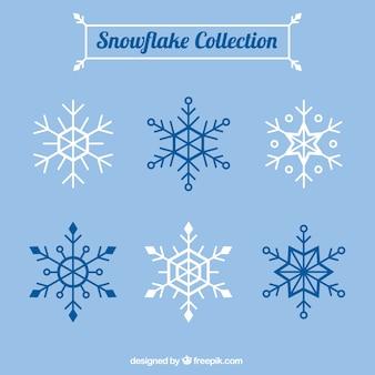 Set di fiocchi di neve in design piatto