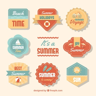 Set of summer labels with beach elements in vintage style