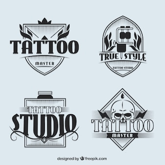 Set of tattoo studio logotypes in vintage style