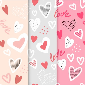 Set of three childish patterns with hand drawn hearts