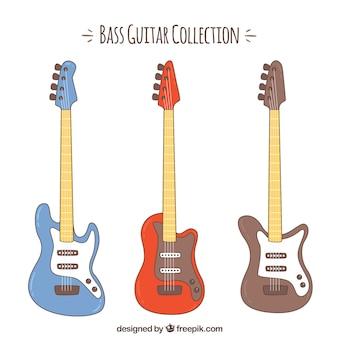 Set of three colored bass guitars