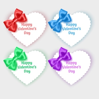 Set of valentines day cards in the shape of a heart decorated with realistic bows of bright colors Premium Vector