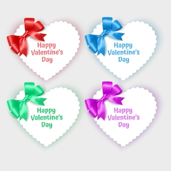 Set of valentines day cards in the shape of a heart decorated with realistic bows of bright colors