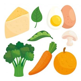 白い背景の上の果物と健康食品と野菜を設定します。