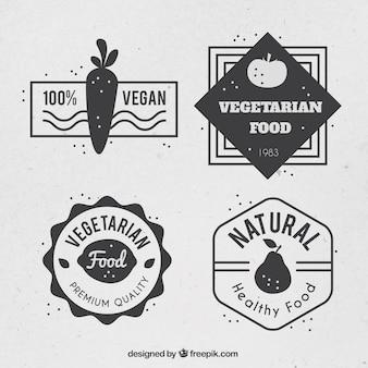 Insieme dei distintivi vegan d'epoca
