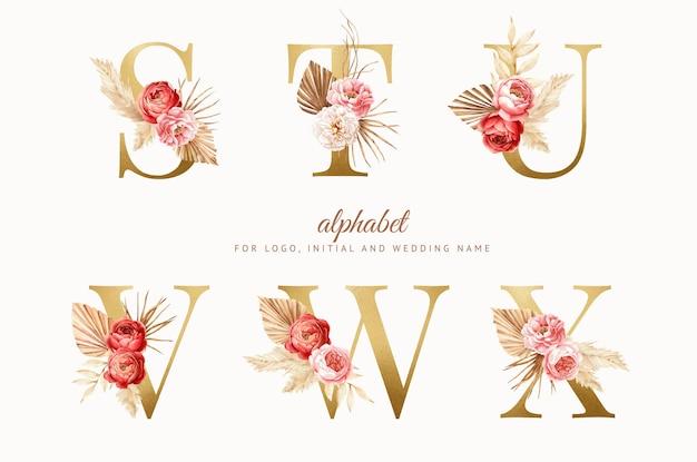 황금 문자로 수채화 boho 꽃 알파벳을 설정