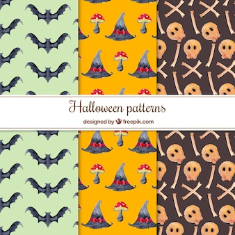 Set of watercolor patterns with skulls and other elements