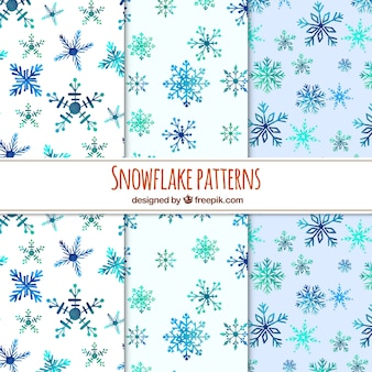 Set of watercolor snowflakes patterns Free Vector