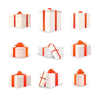 Set of white bright gift boxes with red tapes and bows