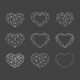 Set of white geometric polygonal hearts. icons isolated on dark background
