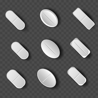 Set of white pills and tablets on transparent background