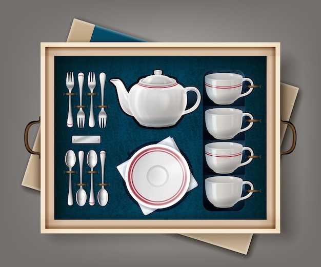 Set of white porcelain set for tea or coffee and cutlery set in a case