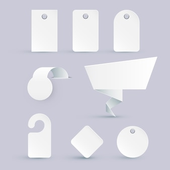 Set of white price tags of different shapes with design elements. illustration