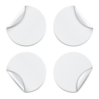 Set of white round paper stickers on white